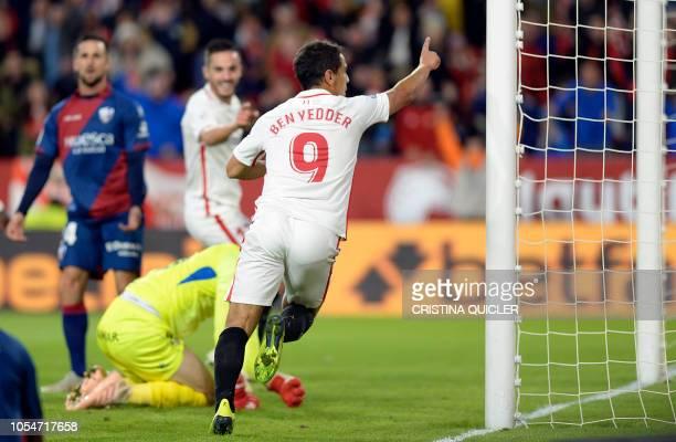 Sevilla's French forward Wissam Ben Yedder celebrates Sevilla's Spanish midfielder Pablo Sarabia's goal during the Spanish league football match...