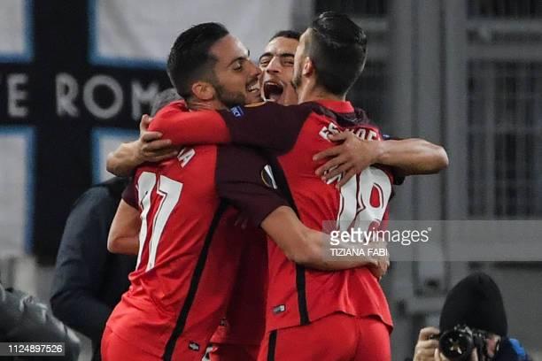 Sevilla's French forward Wissam Ben Yedder celebrates with Sevilla's Spanish midfielder Pablo Sarabia and Sevilla's Spanish defender Sergio Escudero...