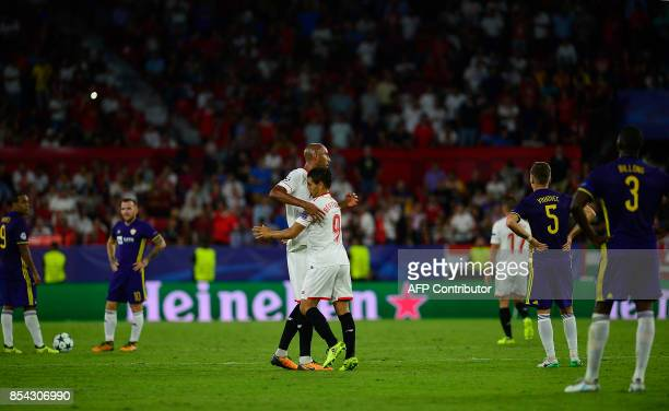 Sevilla's French forward Wissam Ben Yedder celebrates with Sevilla's French midfielder Steven N'Zonzi after scoring during the UEFA Champions League...