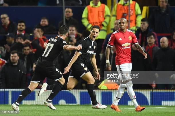 TOPSHOT Sevilla's French forward Wissam Ben Yedder celebrates with Sevilla's Spanish midfielder Pablo Sarabia after scoring during a last 16 second...