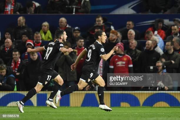 Sevilla's French forward Wissam Ben Yedder celebrates with Sevilla's Spanish midfielder Pablo Sarabia after scoring during a last 16 second leg UEFA...