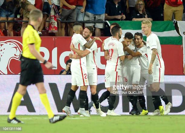Sevilla's French forward Wissam Ben Yedder celebrates with teammates after scoring their third goa during the Spanish league football match Sevilla...