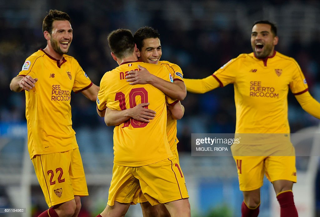 Sevilla's French forward Wissam Ben Yedder (C R) celebrates with teammates after scoring a goal during the Spanish league football match Real Sociedad vs Sevilla FC at the Anoeta stadium in San Sebastian on January 7, 2017. / AFP / MIGUEL