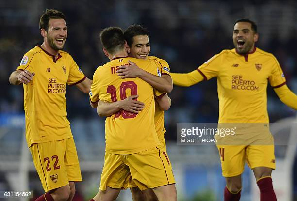 Sevilla's French forward Wissam Ben Yedder celebrates with teammates after scoring a goal during the Spanish league football match Real Sociedad vs...