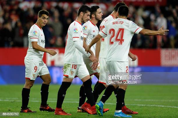Sevilla's French forward Wissam Ben Yedder celebrates with teammates after scoring a goal during the Spanish league football match Sevilla FC vs RC...