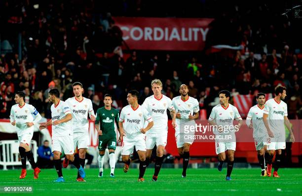 Sevilla's French forward Wissam Ben Yedder celebrates with teammates after scoring a goal during the Spanish league football match between Sevilla...