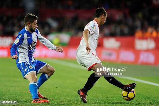 Sevilla's French forward Wissam Ben Yedder challenges Deportivo La Coruna's Argentinian midfielder Federico Cartabia during the Spanish league...