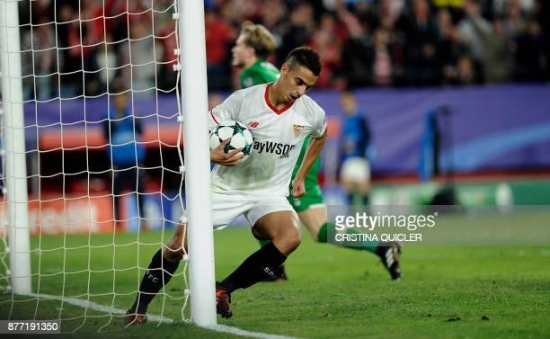 Sevilla's French forward Wissam Ben Yedder grabs the ball after scoring a goal on November 21 2017 at the Ramon Sanchez Pizjuan stadium in Sevilla...