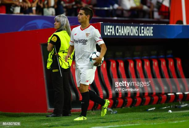 Sevilla's French forward Wissam Ben Yedder leaves the pitch with the ball after performing a hat trick at the end of the UEFA Champions League Group...