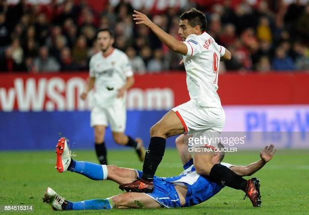Sevilla's French forward Wissam Ben Yedder reacts as he scores a goal during the Spanish league football match Sevilla FC vs RC Deportivo de la...