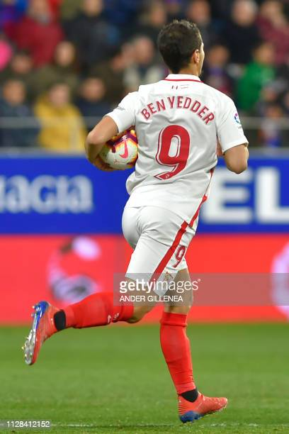 Sevilla's French forward Wissam Ben Yedder runs with the ball after scoring a penalty during the Spanish league football match between SD Huesca and...