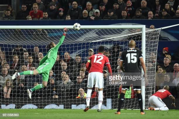 TOPSHOT Sevilla's French forward Wissam Ben Yedder scores their second goal past Manchester United's Spanish goalkeeper David de Gea during a last 16...