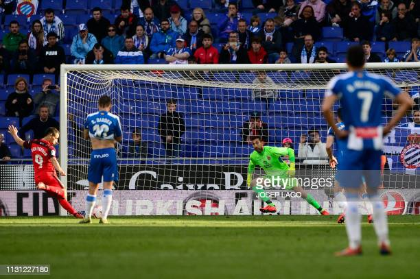 Sevilla's French forward Wissam Ben Yedder shoots a penalty kick to score a goal during the Spanish league football match between RCD Espanyol and...