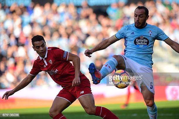 Sevilla's French forward Wissam Ben Yedder vies with Celta Vigo's Chilean midfielder Marcelo Diaz during the Spanish league football match RC Celta...