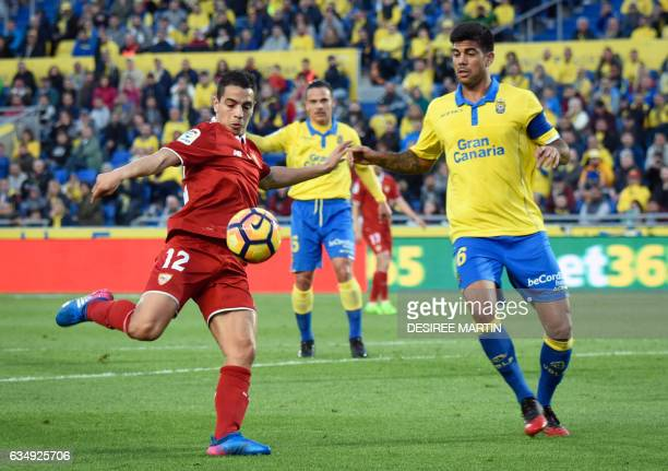 Sevilla's French forward Wissam Ben Yedder vies with Las Palmas' defender Aythami Artiles during the Spanish league football match UD Las Palmas vs...