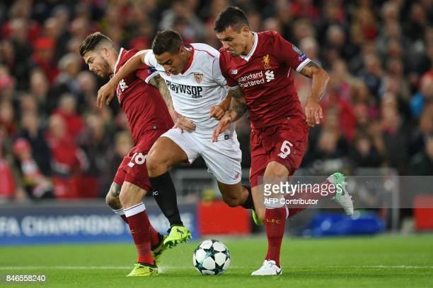 Sevilla's French forward Wissam Ben Yedder vies with Liverpool's Spanish defender Alberto Moreno and Liverpool's Croatian defender Dejan Lovren...