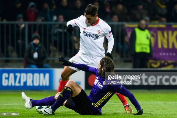Sevilla's French forward Wissam Ben Yedder vies with Maribor's Slovenian defender Marko Suler during the UEFA Champions League Group E football match...