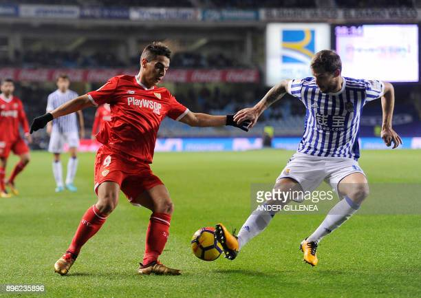 Sevilla's French forward Wissam Ben Yedder vies with Real Sociedad's Spanish defender Inigo Martinez Berridi during the Spanish league football match...