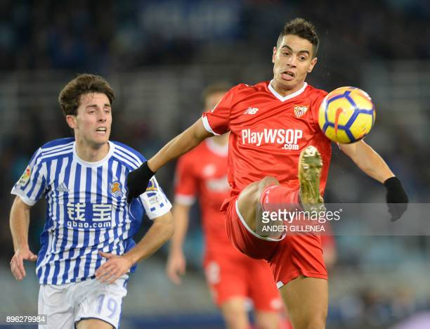 Sevilla's French forward Wissam Ben Yedder vies with Real Sociedad's Spanish defender Alvaro Odriozola during the Spanish league football match Real...
