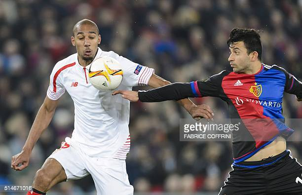 Sevilla's French midfielder Steven N'Zonzi and Basel's Swedish defender Behrang Safari vies during the UEFA Europa League round of 16 first leg...
