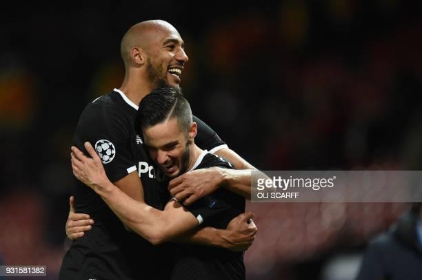 Sevilla's French midfielder Steven N'Zonzi and Sevilla's Spanish midfielder Pablo Sarabia celebrate after winning the last 16 second leg UEFA...