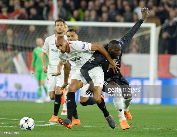 Sevilla's French midfielder Steven N'Zonzi fights for the ball with Manchester United's Belgian forward Romelu Lukaku during the UEFA Champions...