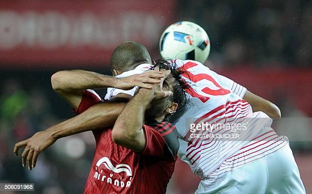 TOPSHOT Sevilla's French midfielder Steven N'Zonzi vies with Mirandes' forward Abdon Prats during the Spanish Copa del Rey football match Sevilla FC...