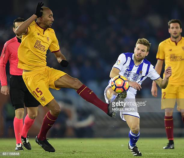 Sevilla's French midfielder Steven N'Zonzi vies with Real Sociedad's midfielder Asier Illarramendi during the Spanish league football match Real...
