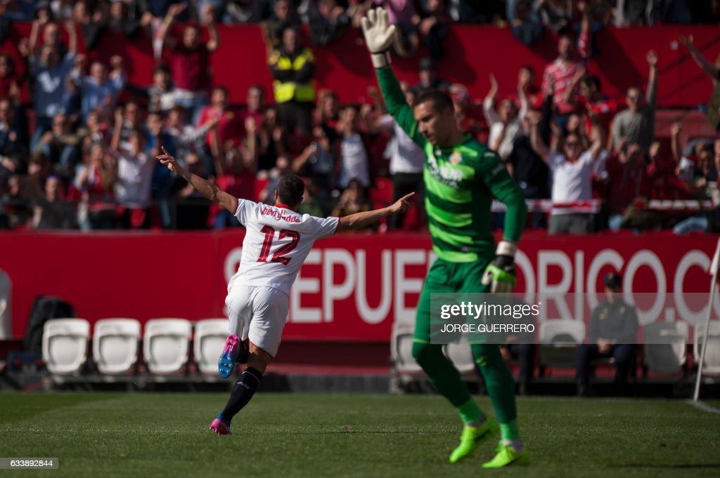 Sevilla's French Tunisian forward Wissam Ben Yedder (L) celebrates an eventually cancelled goal during the Spanish league football match Sevilla FC vs Villarreal CF at the Ramon Sanchez Pizjuan stadium in Sevilla on February 5, 2017. / AFP / JORGE