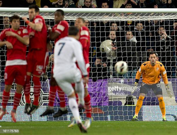 Sevilla's goalkeeper Beto watches Real Madrid's Portuguese forward Cristiano Ronaldo executing a freekick during the Spanish league football match...