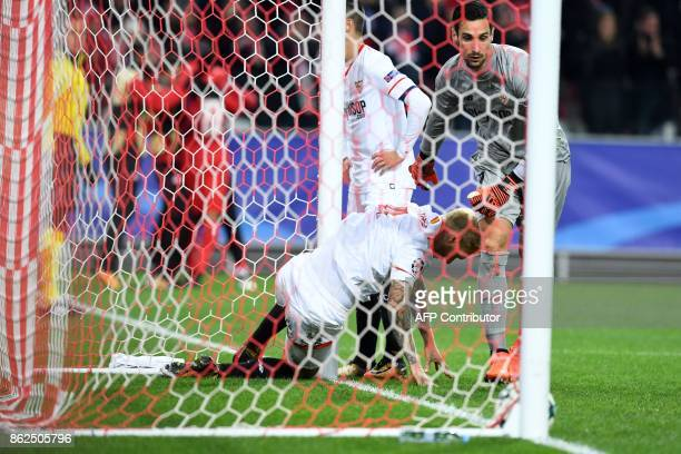 Sevilla's goalkeeper from Spain Sergio Rico Gonzalez reacts after Spartak Moscow's forward from Brazil Luiz Adriano scored the team's fourth goal...