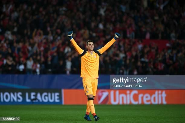Sevilla's goalkeeper Sergio Rico celebrates a goal during the UEFA Champions League round of 16 second leg football match Sevilla FC vs Leicester...