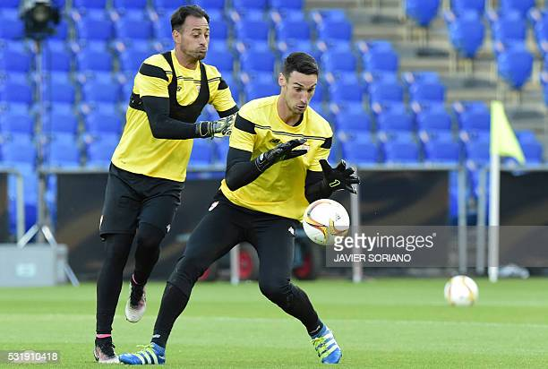 Sevilla's goalkeeper Sergio Rico Gonzalez and Sevilla's Portuguese goalkeeper Beto take part in a training session at the St JakobPark stadium in...