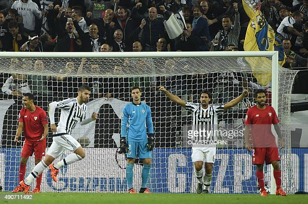 Sevilla's goalkeeper Sergio Rico Gonzalez reacts after Juventus' forward from Spain Alvaro Morata scored during the UEFA Champions League football...
