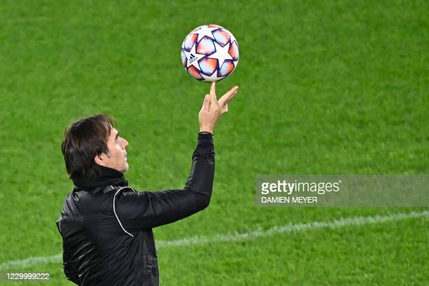 Sevilla's head coach Julen Lopetegui plays with the ball during a training session on the eve of the UEFA Champions league Group E football match...