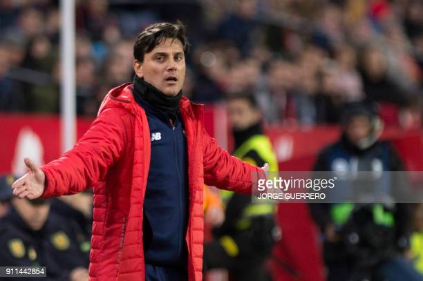 Sevilla's Italian coach Vincenzo Montella gestures during the Spanish league football match between FC Barcelona and Deportivo Alaves at the Camp Nou...