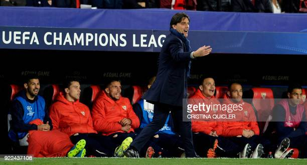 Sevilla's Italian coach Vincenzo Montella gives instructions to the players during the UEFA Champions League round of 16 first leg football match...