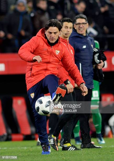 Sevilla's Italian coach Vincenzo Montella kicks the ball at the end of the Spanish 'Copa del Rey' second leg semifinal football match between Sevilla...