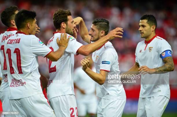 Sevilla's Italian forward Franco Vazquez celebrates after scoring a goal with Sevilla's Argentinian midfielder Joaquin Correa Sevilla's Montenegrin...
