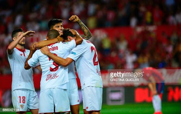 Sevilla's Italian forward Franco Vazquez celebrates after scoring a goal with Sevilla's Brazilian defender Mariano and Sevilla's Argentinian...