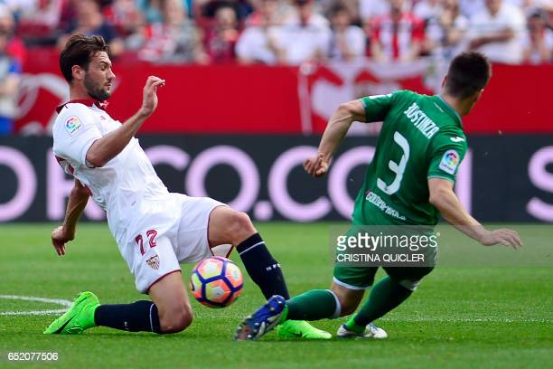 Sevilla's Italian forward Franco Vazquez vies with Leganes' defender Unai Bustinza during the Spanish league football match Sevilla FC vs Club...