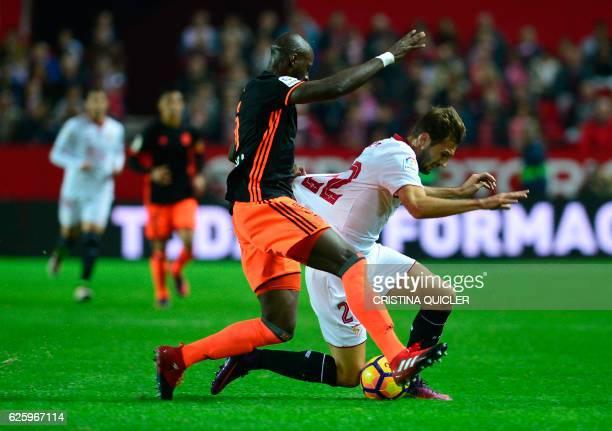 Sevilla's Italian forward Franco Vazquez vies with Valencia's French defender Eleaquim Mangala during the Spanish league football match Sevilla FC vs...
