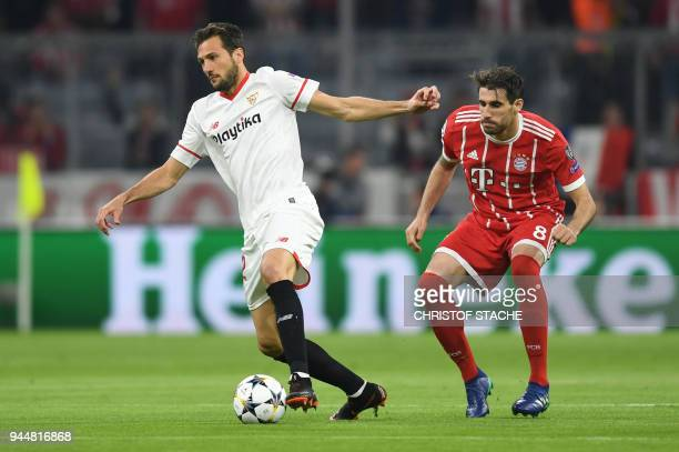 Sevilla's Italian midfielder Franco Vazquez and Bayern Munich's Spanish midfielder Javier Martinez vie for the ball during the UEFA Champions League...