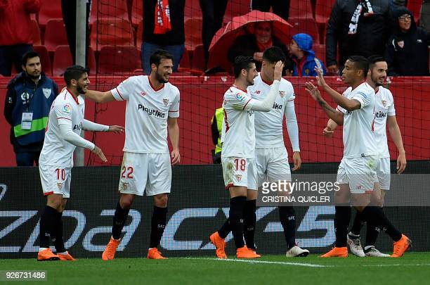 Sevilla's Italian midfielder Franco Vazquez celebrates a goal with teammates during the Spanish league football match between Sevilla FC and Athletic...