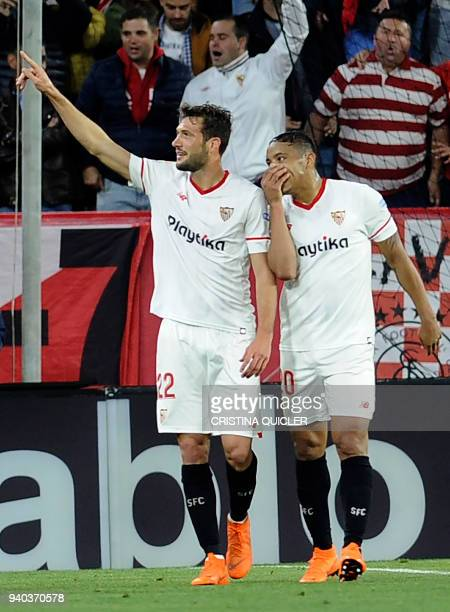 Sevilla's Italian midfielder Franco Vazquez celebrates a goal with teammates during the Spanish League football match between Sevilla FC and FC...