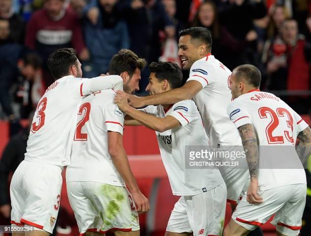 Sevilla's Italian midfielder Franco Vazquez celebrates with teammates after scoring a goal during the Spanish 'Copa del Rey' second leg semifinal...