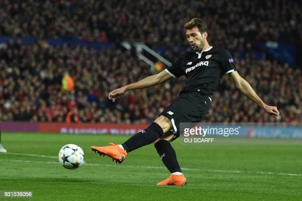 Sevilla's Italian midfielder Franco Vazquez has a shot on goal during a last 16 second leg UEFA Champions League football match between Manchester...