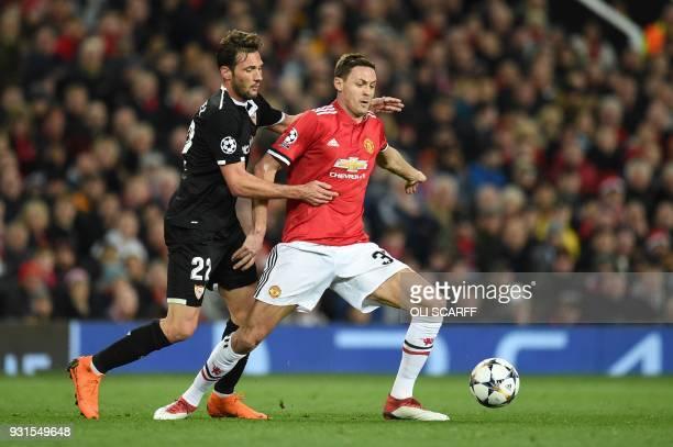 Sevilla's Italian midfielder Franco Vazquez vies with Manchester United's Serbian midfielder Nemanja Matic during a last 16 second leg UEFA Champions...