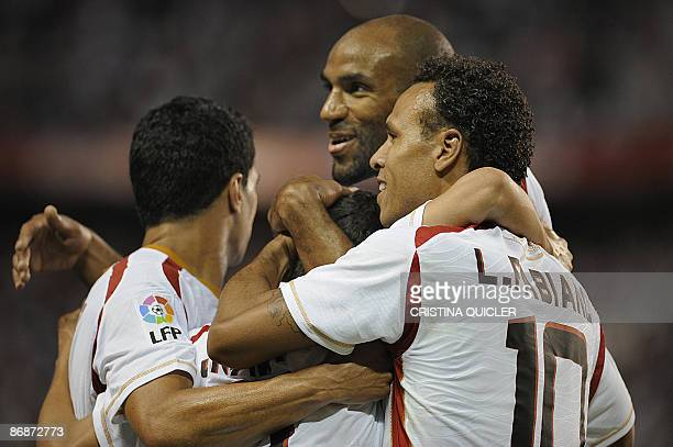 Sevilla's Jesus Navas is congratulated by teammates Luis Fabiano French born Malian Frédéric Kanouté and Renato Dirnei after scoring against Mallorca...
