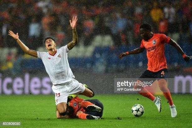 TOPSHOT Sevilla's Joaquin Correa vies for the ball with Basaksehir's Mahmut Tekdemir and Joseph Attamah during the UEFA Champions League playoff...